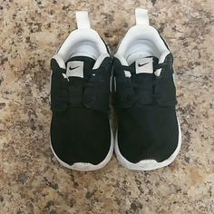 Baby Nikes size 5 Baby Nikes black and white size 5. Not worn very many times because my child has an incredible amount of shoes lol. Super cute though!! Let me know if you are interested :) Nike Shoes Athletic Shoes
