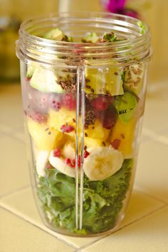Kale, Banana, Pineapple, Frozen Raspberries, Avocado, Flaxseeds, Add Water & Blend w/Nutribullet.