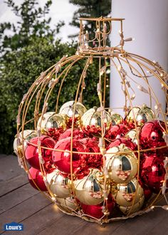 A beautiful red and gold lighted orb filled with ornaments is the perfect way to greet your guests for the holidays. Shop Christmas decorations to get your home holiday ready. Christmas Staircase, Christmas Yard Art, Rustic Christmas, All Things Christmas, Christmas Time, Christmas Specials, Christmas Lights Outdoor Trees, Christmas Lanterns, Outdoor Christmas Decorations
