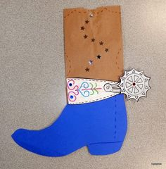 Paper Bag Cowboy Boots.  Cut boot shape from different colored construction paper.  Glue to front of bag.  Decorate