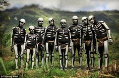 A tribe in Papua New Guinea who paint themselves like skeletons. Photo by Timothy Allen
