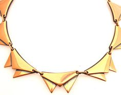 """Add a touch of mid century glam with this unique """"vampire tooth"""" inspired necklace! It's the perfect piece to add to your favorite blouse or add some retro glam to your favorite dresses!"""