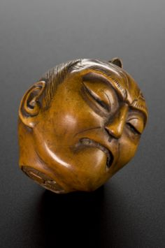 Netsuke in form of decapitated man's head