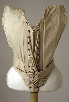 corset c.1900    find the lacing of this piece interesting. it s different from other pieces in that it has no back. it is secure via the top of the bodice (arm holes) and a belt around the waist line