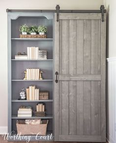 Farmhouse style bookcases with a sliding diy barn door