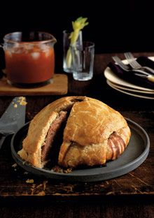 British Pork n Ham pie. 1 Tbsp. unsalted butter  1/2 cup finely diced onion (about 1 small onion)  1 Tbsp. minced garlic (2 cloves)  1 1/2 pounds ground pork  1 cup diced smoked ham  1 Tbsp. coarse salt  1 tsp. ground black pepper  1 tsp. fresh thyme leaves  1/2 cup chicken stock or canned broth , plus 1 cup for aspic (optional), chilled  2 tsp. gelatin for aspic (optional)  1 large egg  1 large egg yolk  1 Tbsp. whole milk  Read more: http://www.oprah.com/food/English-Pork-Pie#ixzz2A4jLCkY6