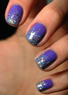 Purple-blue nail polish and chunky GLITTER tips.