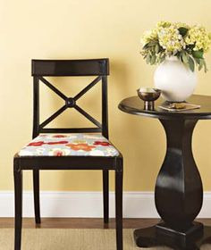 Give the chair a bit of pop by covering it with fabric in a lively pattern. You could even recycle a length of tablecloth you no longer use.
