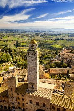 View over the town and countryside of San Gimignano:  Photo Copyright © Mick House San Gimignano Towers