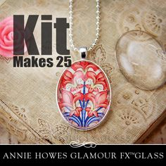 From Annie Howes - Clear Oval Glass Pendant Kit with Pendant Trays, Glamour Glaze, and 25 Silver Plated Ball Chains.