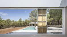 Ca l'Amo - Marià Castelló · Architecture Exterior Shades, Hotel Ibiza, Wooded Landscaping, Dry Stone, White Paneling, Built In Storage, Sliding Glass Door, Detached House, Terrace
