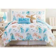 Relax into the coastal lifestyle with bedding accessories by Phi Coastal Collection. This comforter set features a tropical sand dollar, sea shell, starfish, and reef design. Set includes one comforter and two pillwo shams (one for twin size). Beach Cottage Decor, Coastal Cottage, Coastal Decor, Coastal Style, Coastal Bedrooms, Coastal Living Rooms, Beach Bedding, Luxury Bedding, Coastal Bedding