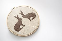 embroidery hoop bunnies... silhouettes in general would be cute.