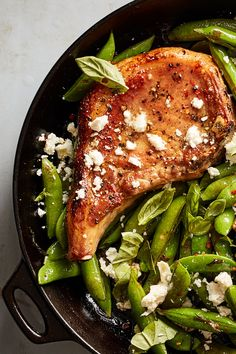 One-Pan Pork Chops With Feta, Snap Peas and Mint Recipe - NYT Cooking