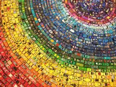 car atlas - rainbow, david waller.  made of 2500 toy cars arranged in a circular rainbow.
