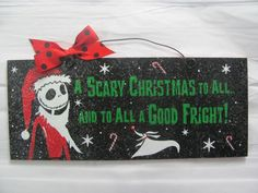 6x12 in. recycled wood sign acrylic paint with print. Coated with indoor/outdoor gloss and clear glitter. Wire and bow accent. Jack Skellington. A Scary Christmas to All. -------( Production & Shippin