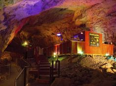 """Go deep underground at the suite at the Grand Canyon Caverns, which sits 220 feet underground and is surrounded by 65-million-year-old """"walls."""""""
