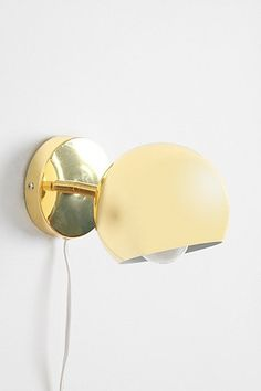 """Eyeball sconce (too cute) from Urban Outfitters for only $29. """"Mid-century modern-inspired wall sconce in enameled metal with a super high-shine finish"""" via Urban Outfitters"""