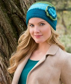 Choose your three favorite colors and combine them in a snuggly cap sure to keep you warm in chily weather. Add a sassy flower and you'll know that spring is not too far away!
