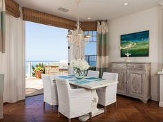 Great art and Currey Chandelier!   For the chandelier http://caronsbeachhouse.com/coastal-lighting/chandeliers-and-wall-sconces/6-light-seaward-coral-shaped-chandelier.html