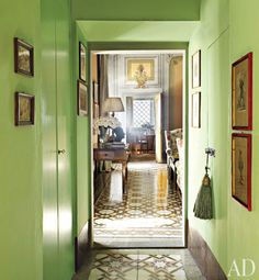 paint a hallway a bright color accented in another room--interesting idea