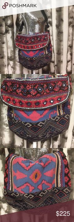 "Free people messenger bag zip fold over x-large Free people BoHo weekender bag XL tapestry new without tags zip closure folds over. Has leather braided straps. Measures when folded. 17"" x 15"" with an 18"" strap. Tapestry with small mirror embellishments and fringe. 1 Free People Bags Satchels"