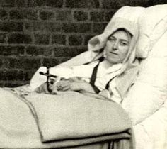 St Therese, The Little Flower, photographed on her deathbed. She suffered dreadfully with Tuberculosis before dying aged only 24.