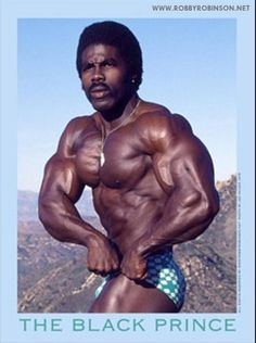 """ROBBY ROBINSON - PHOTO BY JOE VALDEZ ON """"MUSCLE ROCK"""" IN MALIBU BACK IN '76;  AVAILABLE AS 22"""" X 26"""" (56 cm x 66 cm) POSTER AT ▶ www.robbyrobinson.net/poster.php BUILDING THE BODYBUILDER'S FOUNDATION I'M HERE TO TELL YOU, STOP READING THOSE MAGS! HARD WORK, BOTH EATING AND TRAINING, COMPLETED ON A CONSISTENT TIME CLOCK HAS ALWAYS BEEN MY PROGRAM. WITH 45 YEARS OF EXPERIMENTING WITH MY OWN PHYSIQUE, BOTH MENTALLY AND PHYSICALLY, I CAN SAY, """"I'VE GOT THE GAME DOWN!"""""""
