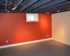 This exposed basement ceiling was spray painted black due to the duct work and pipes to create a visually higher ceiling. Description from houzz.com. I searched for this on bing.com/images