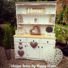 Image from http://uniqueitemsbyhappyhopes.co.uk/ekmps/shops/happyhopes/images/shabby-chic-welsh-dresser-sold-4343-p.jpg.
