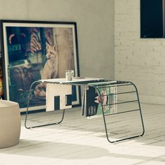 {Marc coffee table/magazine rack combo} by Gauzak - sleek + functional!