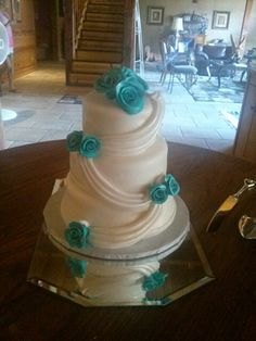 LOVE this Wedding cake....very elegant looking!!! Match the color of the flowers to the wedding colors & it would be perfect!!! I do like the teal/turquoise color pictured.
