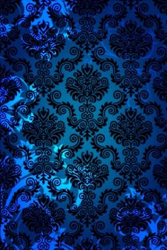 blue damask wall pattern, glowing blue navy teal and black