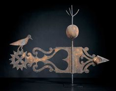 BANNERET AND BIRD WEATHERVANE / artist unidentified, possibly New England, c. 1880, iron and zinc with gold leaf and wood, 34 x 48 x 6 1/2 in., American Folk Art Museum, promised gift of Ralph Esmerian, P1.2001.336, photo © 2000 John Bigelow Taylor, New York