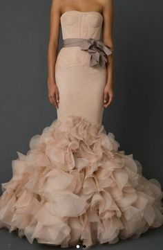 Vera Wang In white would be perfect.