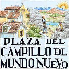 Plaza del Campillo del Mundo Nuevo. En el siglo XVI se desplomó un peñón que existía en este sitio, dejando ver el basto campo de las afueras de Madrid, por lo que la gente llamó a aquel terreno Nuevo Mundo.