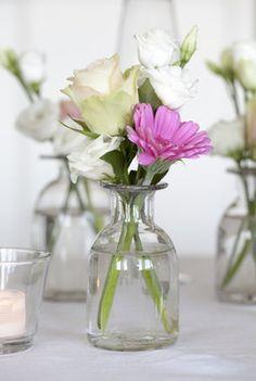 Rose og germini satt sammen i vase.