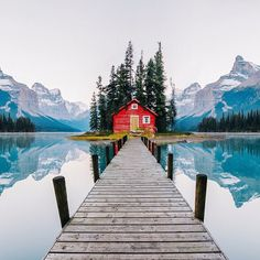 little red cabin on a lake