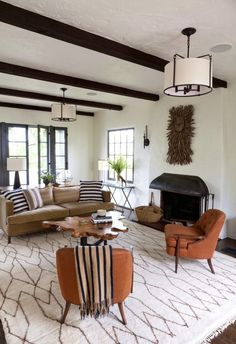 SPANISH COLONIAL REVAMP: #modern living room with live edge coffee #table and beautiful area #rug