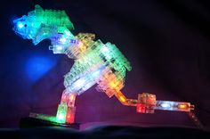 """T-REX dinosaur from Laser Pegs building blocks. Laser Pegs """"National Geographics 24 in 1 Dinosaurs""""  http://www.amazon.com/Laser-Pegs-24-1-Dinosaurs/dp/B00J7S910Q/?tag=unrealbargain-20 is a Lego compatible set of bricks with a twist. It allows to built 24 dinosaur (one at a time). And the dinosaur features cool colored LED light.  See also the youtube video with the dinosaur flashing"""