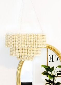 Love this DIY Wood Bead Chandelier - For the patio: