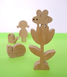 Educational handmade wooden toy Garden play set. Set of 5.  Our toys are safe, ecological, natural and long lasting. Simple design, playful and small size figures are perfect for little hands to hold and use in play.  We want our toys to help kids to familiarise with the world that