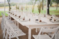 Garden Wedding in Provence: Maya and Lénaïc - Table made by groom & his father and Ikea chairs painted by friends & family