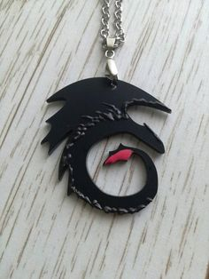 this toothless pendant is perfect for any HTTYD fan! Make the wait for the third film easier by showing off your love for all things toothless with this special, handmade treat! Dragon Necklace, Dragon Jewelry, How To Train Dragon, How To Train Your, Night Fury Dragon, Bff, Httyd, Hiccup, Dragon Rider