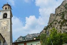 Bell tower and mountains Limone, (Italy) - Learn more about Limone sul Garda in my blog post! #lakegarda #gardasee #lagodigarda #lombardy #lombardei #lombardia #italien #italia #travelblog #travelblogger #reisen #traveltips #reiseblog #breakfast #italian  #slowlife #slow #slowtravel #lake #landscape #reisetipps #travelersnotebok #urlaub #ferien #vacation #vacances #vacaciones #rocks #architecture #architektur