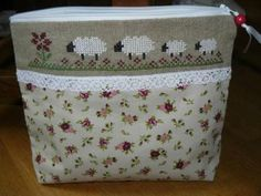Use a cute border design as decoration on a small zippered purse.
