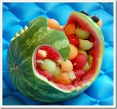 How great is that - carve the watermelon and fill it with colorful ball of honeydew melon, cantaloupe and watermelon. Perfect birthday party snack!