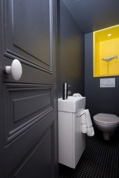 Rhin & Danube | Archipelles PARIS Agency.  Colorful toilet. Contrast dark gray and yellow. Downstairs Loo, Design Agency, Bordeaux, Interior Architecture, Bathrooms, Contrast, Kitchens, Design Inspiration, Colorful