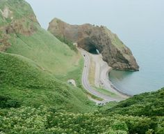 A view of the Echigo Nanaura Seaside Line (National Highway No. from the slopes of Mt. The road passes through a tunnel in that rock outcropping. Mother Earth, Mother Nature, Beautiful World, Beautiful Places, Pokemon Regions, Moonrise Kingdom, Film Photography, Pretty Pictures, Countryside