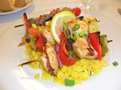 Grilled Shrimp Kabobs over yellow rice — at Jimmy's Fish House & Iguana Bar. #ClwbTasteFest #ClwbRestaurantWeek